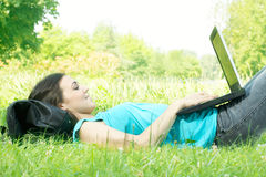 Happy student using laptop. At the park Royalty Free Stock Photos