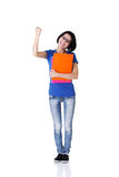 Happy student woman. With notebooks showing win gesture with fist, isoalted on white background Stock Images
