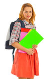 Happy student woman. Holding colorful notebooks isolated on white background Stock Photo