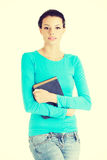 Happy student woman with book Stock Image
