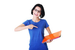 Happy student woman with notebooks. Isoalted on white background Stock Image