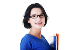 Happy student woman with notebooks. Isoalted on white background Royalty Free Stock Photo