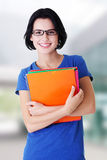 Happy student woman with notebooks Stock Image