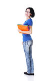 Happy student woman with notebooks. Isoalted on white background Stock Photo