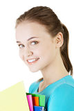 Happy student woman with notebooks. Isoalted on white background Stock Images
