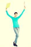 Happy student woman showing win gestur. Happy student woman with notebooks showing win gesture Stock Image
