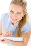 Happy student woman write notes on white Stock Images