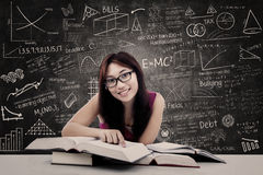 Happy student and written blackboard Stock Images