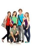 Happy students. Group of five young friends standing together Royalty Free Stock Images