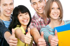Happy students. Group of happy students giving the thumbs-up sign Stock Image