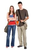 Happy students. Young woman and man standing with books and bags, isolated on white Stock Photography