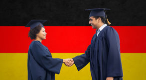 Happy students or bachelors greeting each other Stock Photos