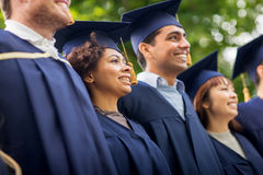 Happy students or bachelors in mortar boards Stock Image