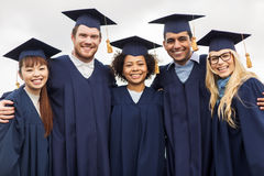 Happy students or bachelors in mortar boards Royalty Free Stock Photography
