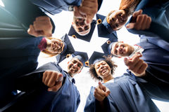 Happy students or bachelors pointing finger at you Stock Image