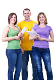Happy students with books. Group of young happy students standing with books Royalty Free Stock Photo