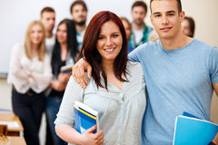 Happy students with books Royalty Free Stock Images