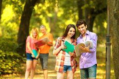 Happy students with books in the Park on a Sunny day. Royalty Free Stock Images