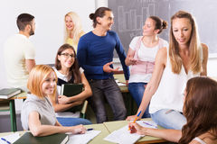 Happy students during break in classroom Stock Image