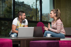 Happy Students In Cafe With Laptop Royalty Free Stock Photos