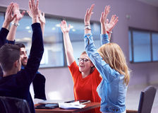Happy students celebrate. Friends group together at school,  young people raise hands, stack and get in circle  formation together Royalty Free Stock Photography