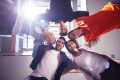 Happy students celebrate Stock Photos