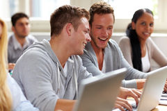Happy students chatting in class Stock Images