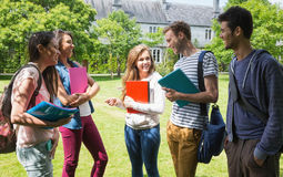 Happy students chatting together outside Stock Photography