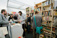 Happy students choose books at the book market Stock Photography