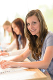 Happy students in classroom Royalty Free Stock Photo