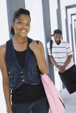 Happy Students At College Corridor Stock Photo