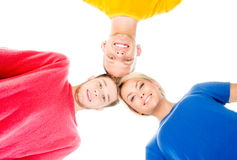 Happy students in colorful clothing Stock Images