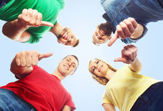 Happy students in colorful clothing standing together. Education Stock Image