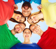 Happy students in colorful clothing standing together. Education Stock Photos