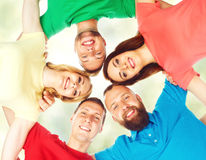 Happy students in colorful clothing standing together. Education Royalty Free Stock Image