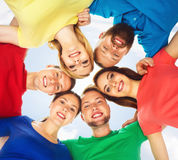 Happy students in colorful clothing standing together. Education Stock Photo