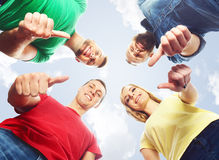 Happy students in colorful clothing standing together. Education. Happy, smiling friends standing together over sky background. Education, college, university Stock Photo