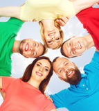 Happy students in colorful clothing standing together. Education Royalty Free Stock Photo