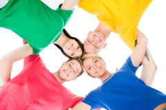 Happy students in colorful clothing standing together hugging Stock Images