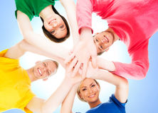 Happy students in colorful clothing standing together Stock Photography