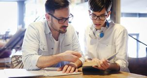 Students couple in school studying for exams together Royalty Free Stock Image