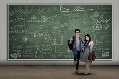 Happy students expressing success at class Stock Images
