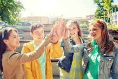 Happy students or friends making high five royalty free stock photography