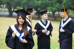 Happy students in graduation gowns Royalty Free Stock Images