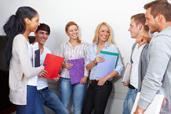 Happy students having a break Royalty Free Stock Image