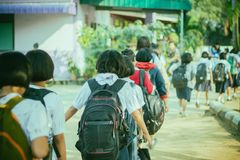 Happy students having fun on street after school. Happy elementary students having fun on street after school Royalty Free Stock Image
