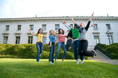 Happy students jumping Royalty Free Stock Images