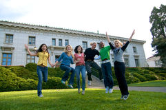 Happy students jumping. A diverse group of multicultural students on campus. A photo of Asian, African American, Hispanic and Caucasian students Stock Photo