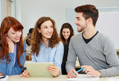 Students with tablet computer Royalty Free Stock Photo