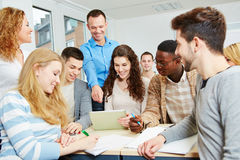 Students with teacher in class. Happy students learning with teacher in university class stock photos
